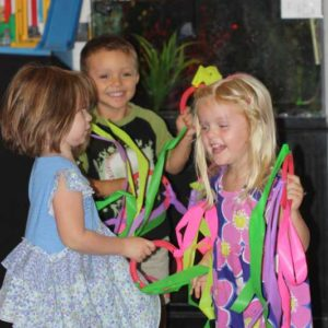giggling preschool kids dancing with creativity and enjoyment