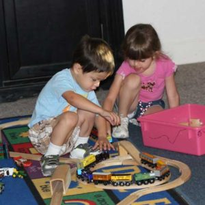 Preschool duo playing with trains