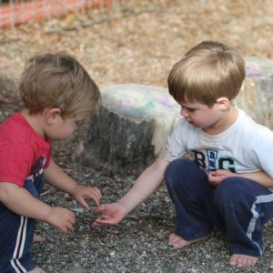 Preschool children outdoors integrating nature in play