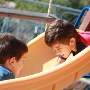 preschool slide with boys having fun